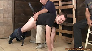 Naked gay lad endures ass spanking and anal with older males