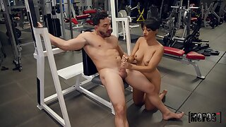 MILF jerks man's dick down at the gym then gets laid with him
