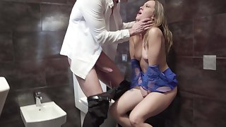 Blonde whore tries a big one in the restaurant's toilet
