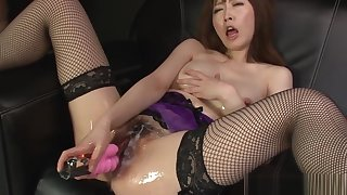 Asian slut strips sexy lingerie during the slippery masturba